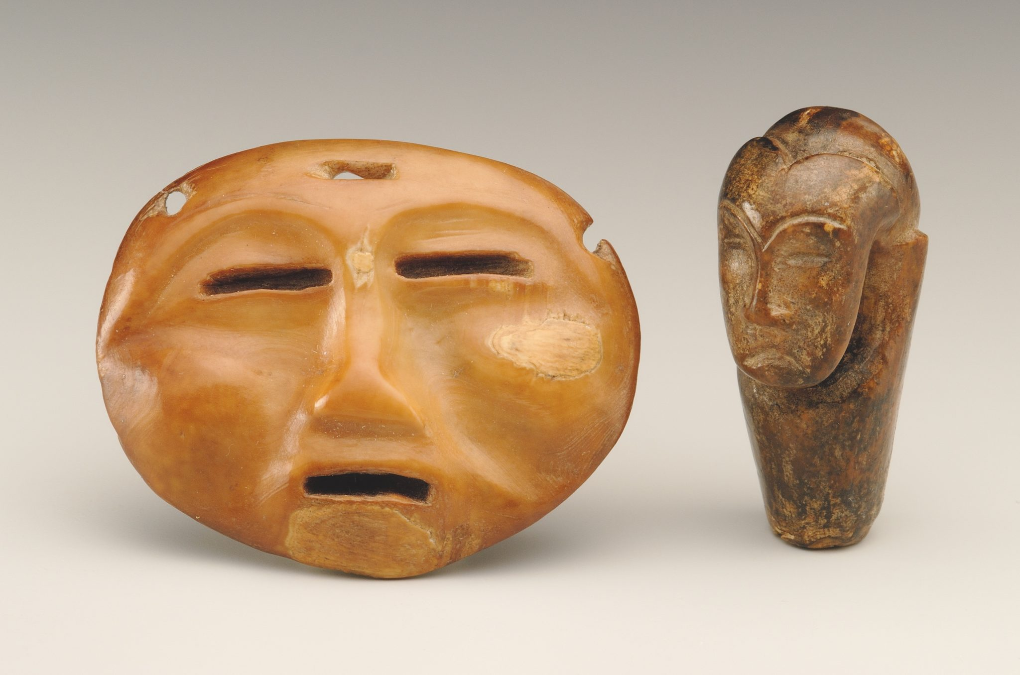 Mask-like object and janiform pendant (?) from the ancient Eskimo burial site Ekven (Old Bering Sea culture, OBS II). Material: walrus tusk. State Museum of Oriental Art, Moscow (photo Ye. Zheltov)
